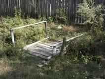 Romanian village. Old wooden bridge in the village of RoÈ™ia, MehedinÈ›i county, Romania stock photos