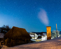 Romanian village under the stars. Beautiful Romanian village under a cold winter sky Stock Photography