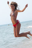 Romanian woman with bikini in Hellenic beach Royalty Free Stock Photography