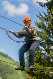 Romanian Woman Wearing Casual Clothing On Zip-Line stock photo