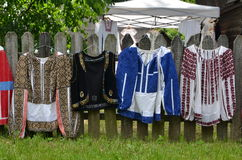 Romanian traditional women`s blouses. Original Romanian old handmade women`s blouses with old fashioned design elements exposed outdoors stock photos