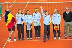 The romanian women tennis team - Simona Halep saluting. The romanian women tennis team presented in the beginning of the Romania-Serbia match Stock Images