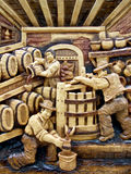 Romanian wood carving. Wood carving presenting traditional activities Stock Photo
