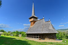 Romanian wooden church with polygonal plan. Royalty Free Stock Photography