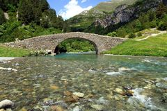 Romanic bridge of Bujaruelo in the region of Aragón in Spain. The river Ara is a river in the northeast of Spain, on the southern slope of the Pyrenees, which Stock Image