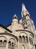 Romanic Cathedral. A perspective view of the Cathedral of San Geminiano with the Ghirlandina Tower - Modena, Italy royalty free stock photos