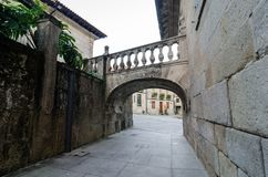 Romanic small arch bridge crossing over the street in Pontevedra Spain. With a historic plaza Stock Photos