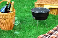 Romanic Weekend Picnic With BBQ Grill And Champagne Concept royalty free stock image