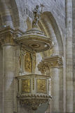 Romano Catholic Cathedral Pulpit. Alba Iulia, Romania - July 24, 2016: Stone pulpit with golden bass-reliefs inside Romano Catholic Cathedral of Alba Iulia Stock Photos