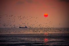 Romansk solnedgång på smällbajset Arkivbilder
