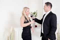 Romantic Affairs. A young men wants to seduce the attractive young blond woman Royalty Free Stock Images