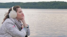 Romantic affecting mood autumn woman on lake background portrait.  stock footage