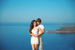 Romantic affectionate young couple in love on vacation over sea Royalty Free Stock Images