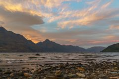 Romantic afterglow after sunset over lake wakatipu, queenstown, new zealand 2. Romantic afterglow after sunset with red sky over lake wakatipu, queenstown stock photo