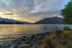 Romantic afterglow after sunset over lake wakatipu, queenstown, new zealand 4. Romantic afterglow after sunset with red sky over lake wakatipu, queenstown stock images