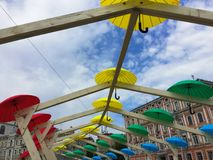 Romantic alley of colorful umbrellas. Festive city decorations Royalty Free Stock Photos