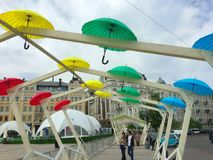 Romantic alley of colorful umbrellas. Spring alley in the city square with umbrellas Royalty Free Stock Photo