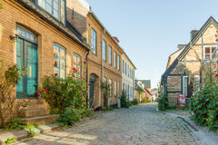 Romantic alley in Lund, Sweden. Old houses in Lund Sweden with roses on the pavement Stock Photos