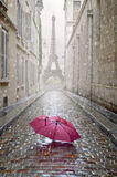 Romantic alley on a rainy day. Rmantic alley on a rainy day with red umbrella Stock Photo