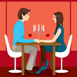Romantic Anniversary Dinner. Young adult couple drinking red wine after romantic anniversary dinner together in elegant restaurant Stock Photos