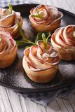 Romantic apple cake in the shape of roses close-up vertical Stock Photo