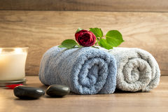 Romantic arrangement of two rolled towels with a beautiful red r Stock Photo