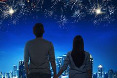 Romantic asian couple enjoying fireworks view. With night scene background royalty free stock photos