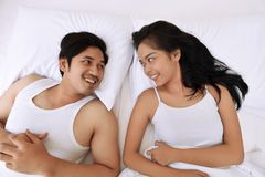 Romantic asian couple lying down and looking each other Royalty Free Stock Photos