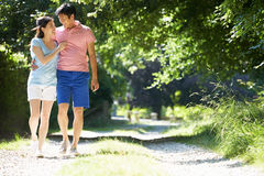 Romantic Asian Couple On Walk In Countryside Stock Photos
