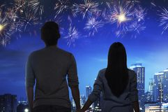 Romantic asian couple watch the fireworks together. On the city at night stock photo