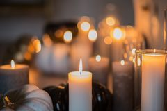 Romantic atmosphere with candles. Candles on the table. Close-up.  royalty free stock photography