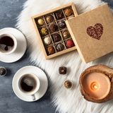 Romantic atmosphere two cups of coffee, chocolate candies and candles. Happy Valentines Day. Top view stock images