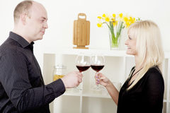 Man and woman toasting each other Royalty Free Stock Photo