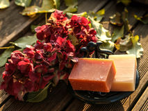 Romantic autumnal still life of flowers and soaps Royalty Free Stock Photo