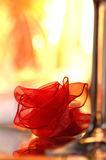 Romantic background. Artificial red rose and glass on the white background Stock Image