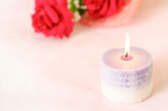 Romantic background - Aroma candle with red rose Stock Photography