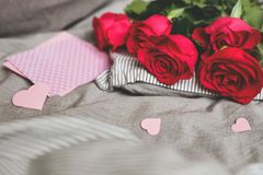 Romantic background with copy space. Beautiful roses and card with heart. Selective focus Stock Photography