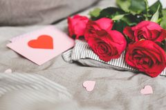 Romantic background with copy space. Beautiful roses and Valentine card with heart. Selective focus Royalty Free Stock Photography