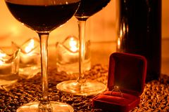 Romantic background with glasses of wine and ring Royalty Free Stock Photos