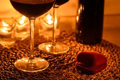 Romantic background with glasses of wine and ring Stock Images
