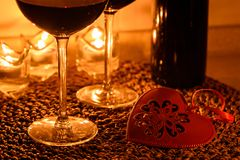 Romantic background with glasses of wine and ring Stock Image