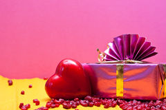 Romantic background with heart and gift Royalty Free Stock Photo