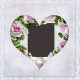 Vintage love background with frame in the shape of heart, roses, wedding rings Stock Photography