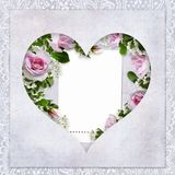 Vintage love background with frame in the shape of heart, beautiful roses, card for text or photo Royalty Free Stock Images