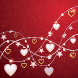 Romantic background with pearl beads and hearts Royalty Free Stock Image