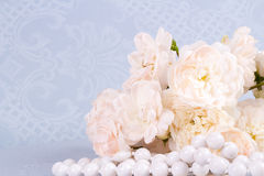 Romantic background with rose. Romantic vintage background with rose and necklace Stock Image