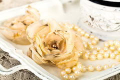 Romantic background with roses, pearls necklace, old lace Stock Images