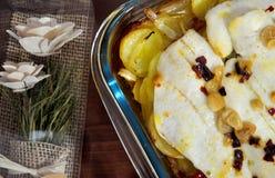 Romantic baked hake with potatoes Royalty Free Stock Photos