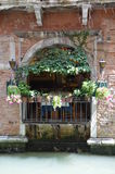 Romantic balcony - Venice - Italy. A romantic balcony of a restaurant in Venice - Italy, right above one of the famous canals Stock Image