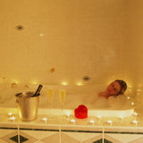 Romantic bath. Young woman during romantic bath Stock Photography